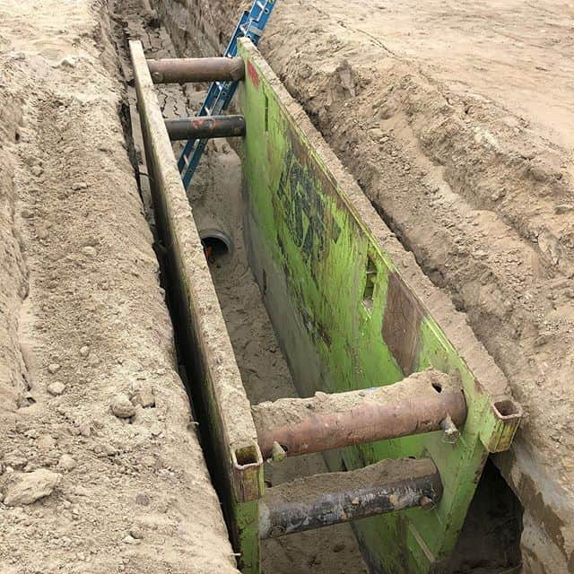 Sandy soil is only good at the beach, not in a trench where people need to work. Trench shields are a great option to keep most of the sand back, so workers can lay pipe. #safetyfirst #treborshoringrentals #trenchshorerentals #naxsa #nuca #trenchshoring #gogreen