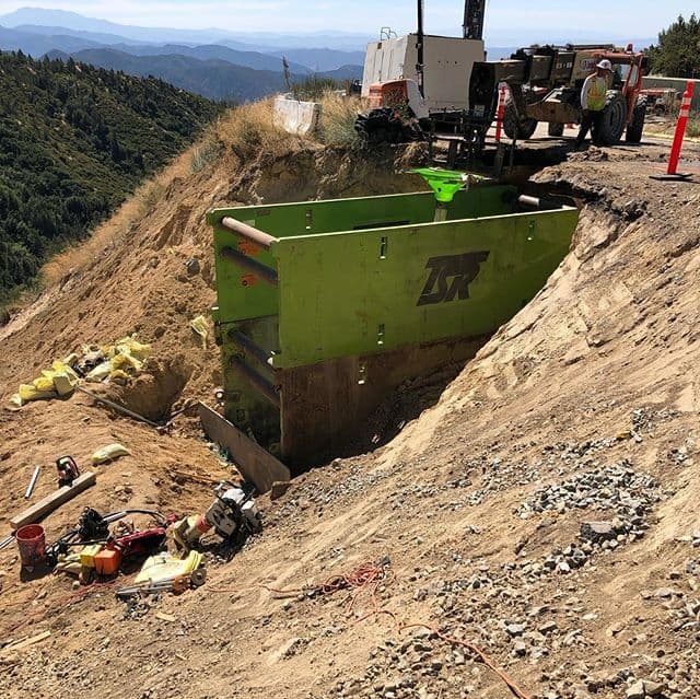 "Even in higher elevations shoring is needed. This job in particular is for CalTrans district 8. Our customer is using our shields to achieve a depth of 24' to install a 42"" drainage pipe. #undergroundconstruction #treborshoringrentals #trenchshorerentals #trenchshoring #trenchshields #shoring #caltrans #caltransdistrict8"