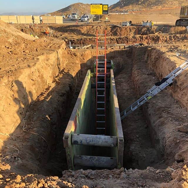Pipeline work out in the IE today. Going green is a great way to start the day! #gogreen #gogreen #treborshoringrentals #trenchshorerentals #trenchshoring #pipeline #trenchshields